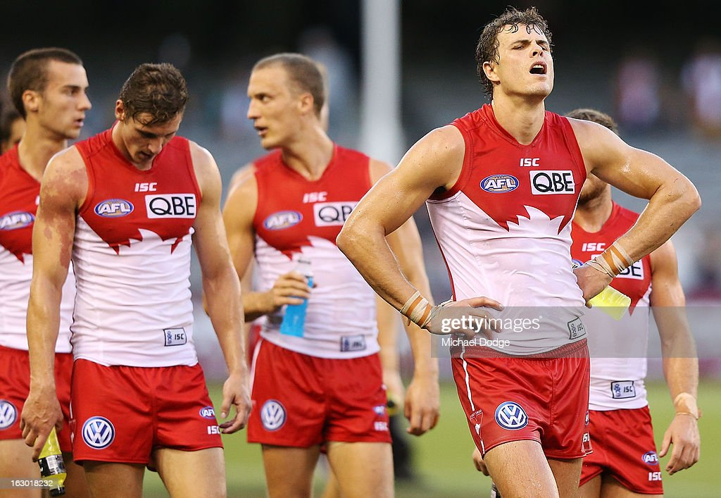 Mike Pyke (R) of the Sydney Swans walks off the ground after the loss during the round two AFL NAB Cup match between the St Kilda Saints and the Sydney Swans at Etihad Stadium on March 3, 2013 in Melbourne, Australia.