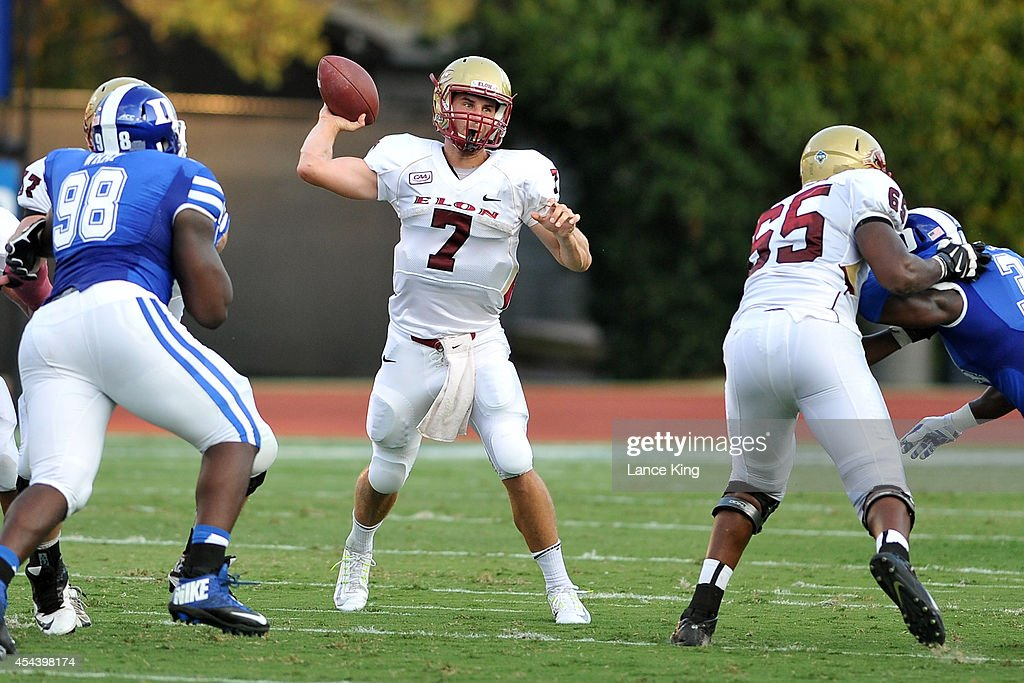 Mike Quinn #7 of the Elon Phoenix passes the ball against the Duke Blue Devils at Wallace Wade Stadium on August 30, 2014 in Durham, North Carolina.