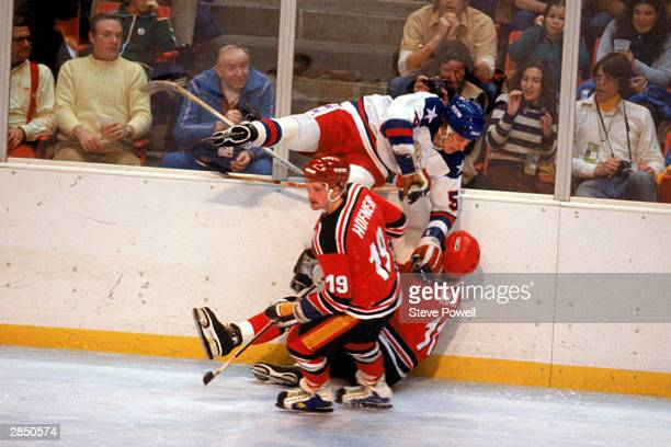 Mike Ramsey of the United States checks a player from West Germany during the Olympic hockey game on February 20 1980 in Lake Placid New York The...