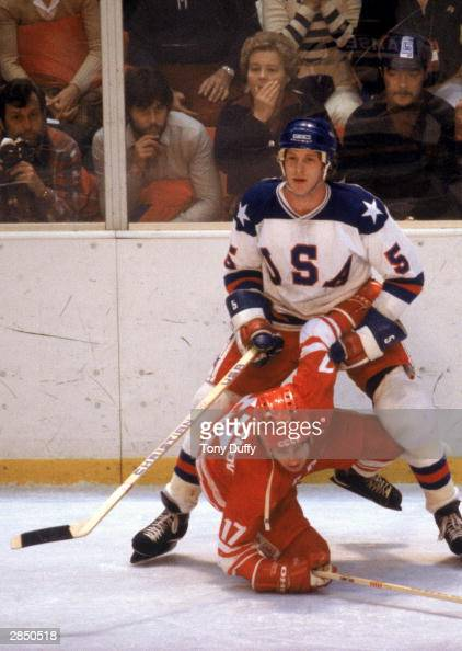Mike Ramsey of the United States stands over Valeri Kharlamov of the Soviet Union during the Winter Olympic Games on February 22 1980 in Lake Placid...