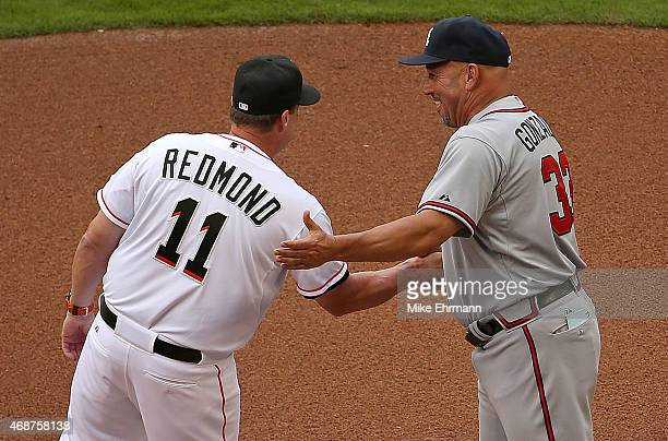 Mike Redmond of the Miami Marlins and Fredi Gonzalez of the Atlanta Braves talk during Opening Day at Marlins Park on April 6 2015 in Miami Florida