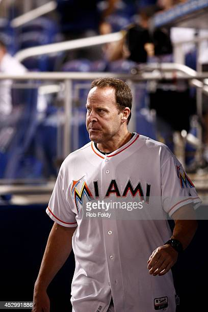 Mike Redmond of the Miami Marlins exits the game after getting thrown out during the eighth inning of the game against the Cincinnati Reds at Marlins...