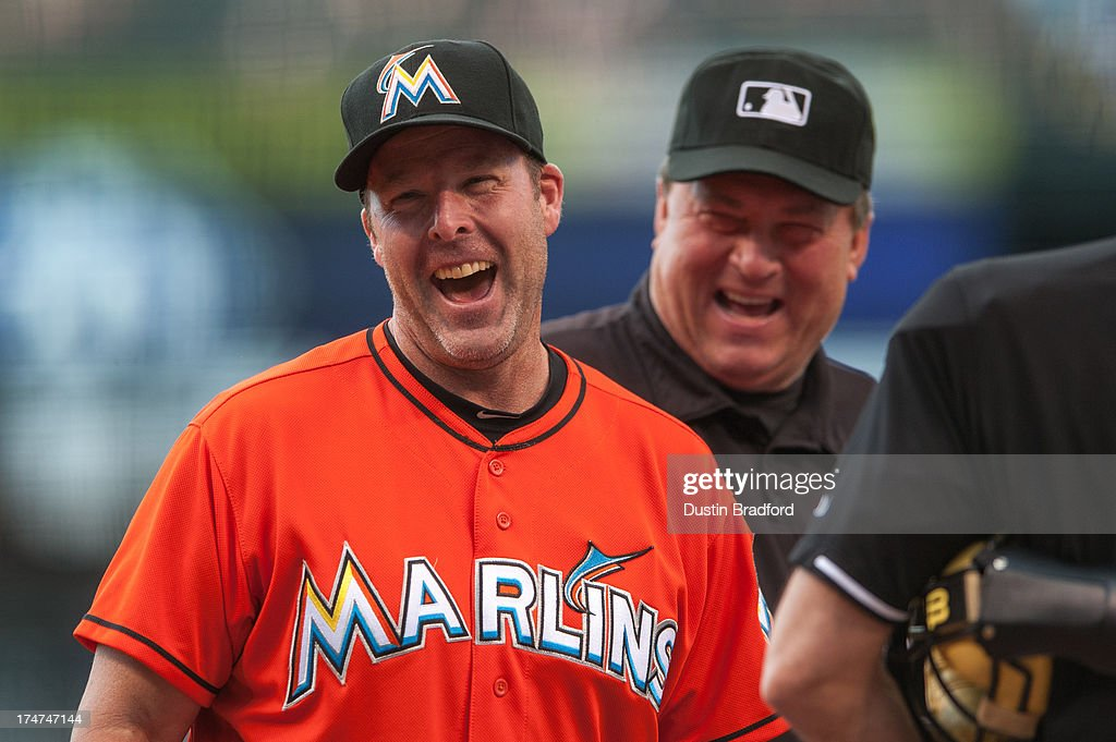 <a gi-track='captionPersonalityLinkClicked' href=/galleries/search?phrase=Mike+Redmond&family=editorial&specificpeople=228450 ng-click='$event.stopPropagation()'>Mike Redmond</a> #11 of the Miami Marlins laughs as he meets with the umpiring crew before a game against the Colorado Rockies at Coors Field on July 24, 2013 in Denver, Colorado.