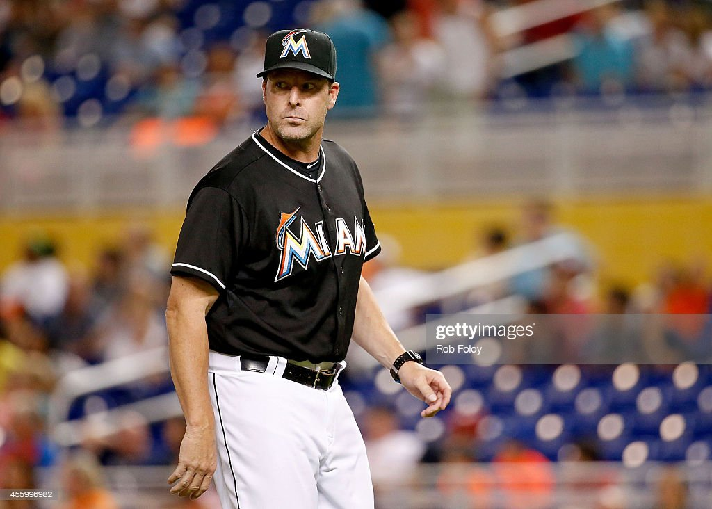 Mike Redmond #11 of the Miami Marlins walks back to the dugout during the eighth inning of the game against the Philadelphia Phillies at Marlins Park on September 23, 2014 in Miami, Florida.