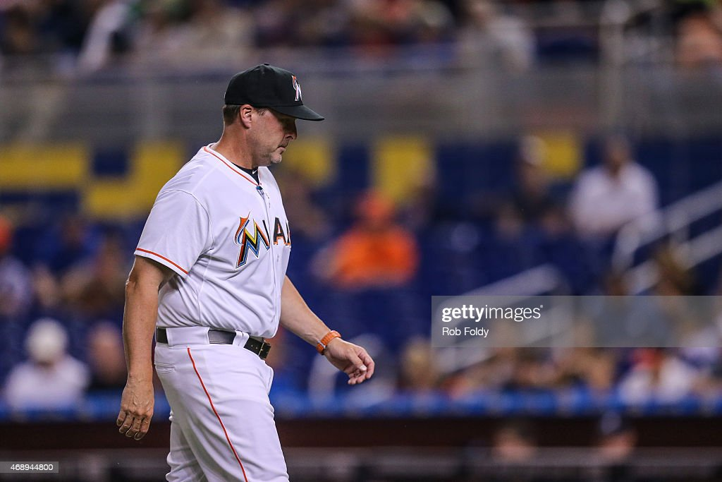 Mike Redmond #11 of the Miami Marlins walks off the field during the first inning of the game against the Atlanta Braves at Marlins Park on April 7, 2015 in Miami, Florida.