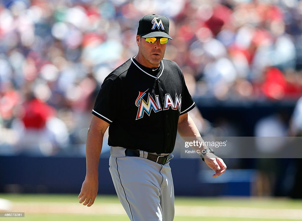 Mike Redmond #11 of the Miami Marlins walks off the field during the third inning against the Atlanta Braves at Turner Field on April 23, 2014 in Atlanta, Georgia.