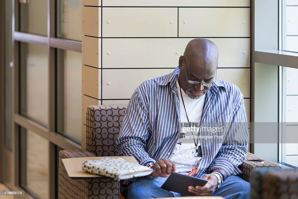 Mike Regan downloads articles onto his Nook ereader at the newly renovated Woodrow Wilson Library in Falls Church Virginia on May 8th Regan lives in...