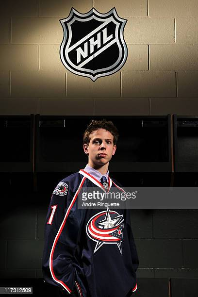 Mike Reilly drafted 98th overall by the Columbus Blue Jackets poses for a portrait during day two of the 2011 NHL Entry Draft at Xcel Energy Center...