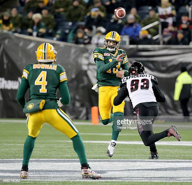 Mike Reilly of the Edmonton Eskimos fires a pass to Adarius Bowman before getting hit by Justin Capicciotti of the Ottawa Redblacks during the first...
