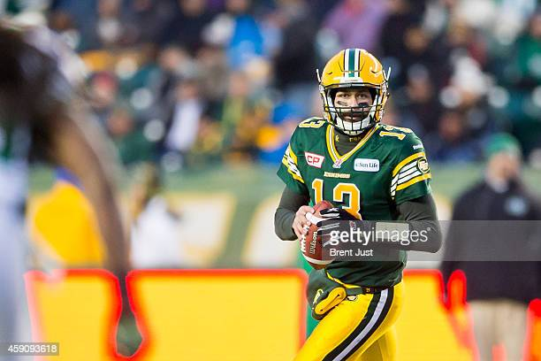 Mike Reilly of the Edmonton Eskimos looks downfield for a receiver in the CFL Western SemiFinal game between the Saskatchewan Roughriders and...