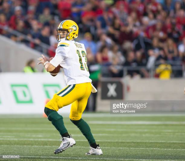 Mike Reilly of the Edmonton Eskimos looks downfield for a receiver against the Ottawa Redblacks in Canadian Football League action at TD Place in...
