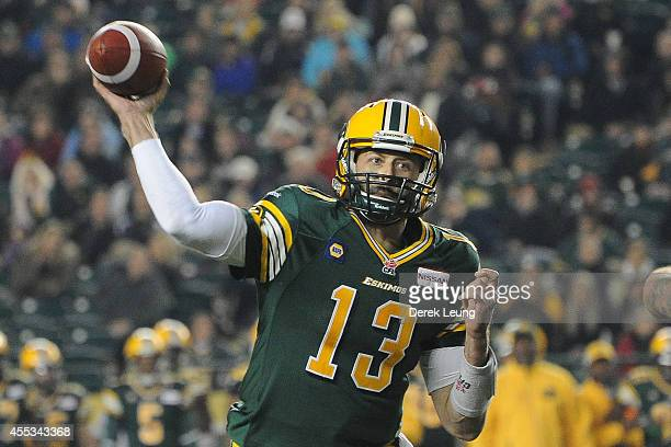 Mike Reilly of the Edmonton Eskimos makes a pass against the Montreal Alouettes during a CFL game at Commonwealth Stadium on September 12 2014 in...