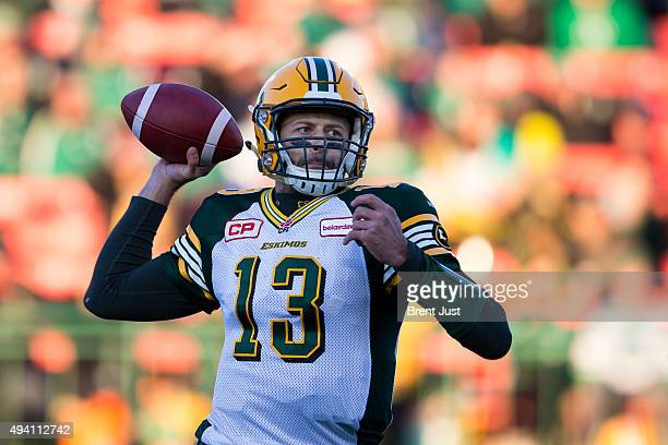 Mike Reilly of the Edmonton Eskimos throws a pass in the first half of the game between the Edmonton Eskimos and Saskatchewan Roughriders in week 18...