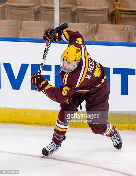 Mike Reilly of the Minnesota Golden Gophers breaks his stick taking a shot against the Minnesota Duluth Bulldogs during the NCAA Division I Men's Ice...