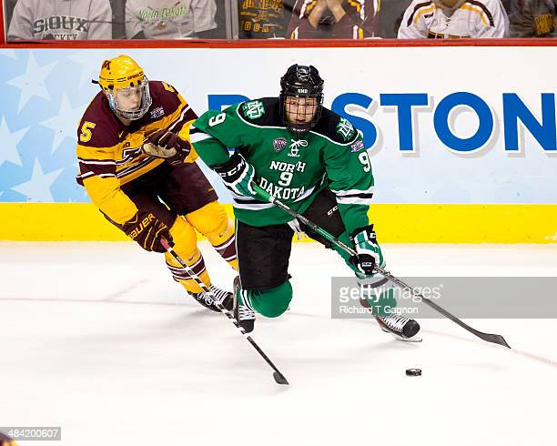 Mike Reilly of the Minnesota Golden Gophers chases Drake Caggiula of North Dakota during the NCAA Division I Men's Ice Hockey Frozen Four...