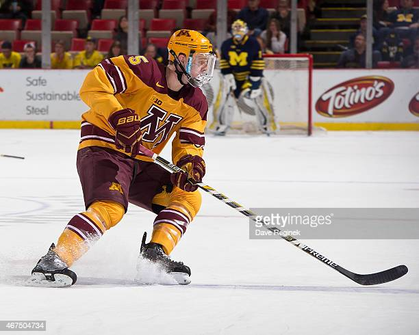 Mike Reilly of the Minnesota Golden Gophers follows the play against the Michigan Wolverines during the finals of Big Ten Mens Ice Hockey...