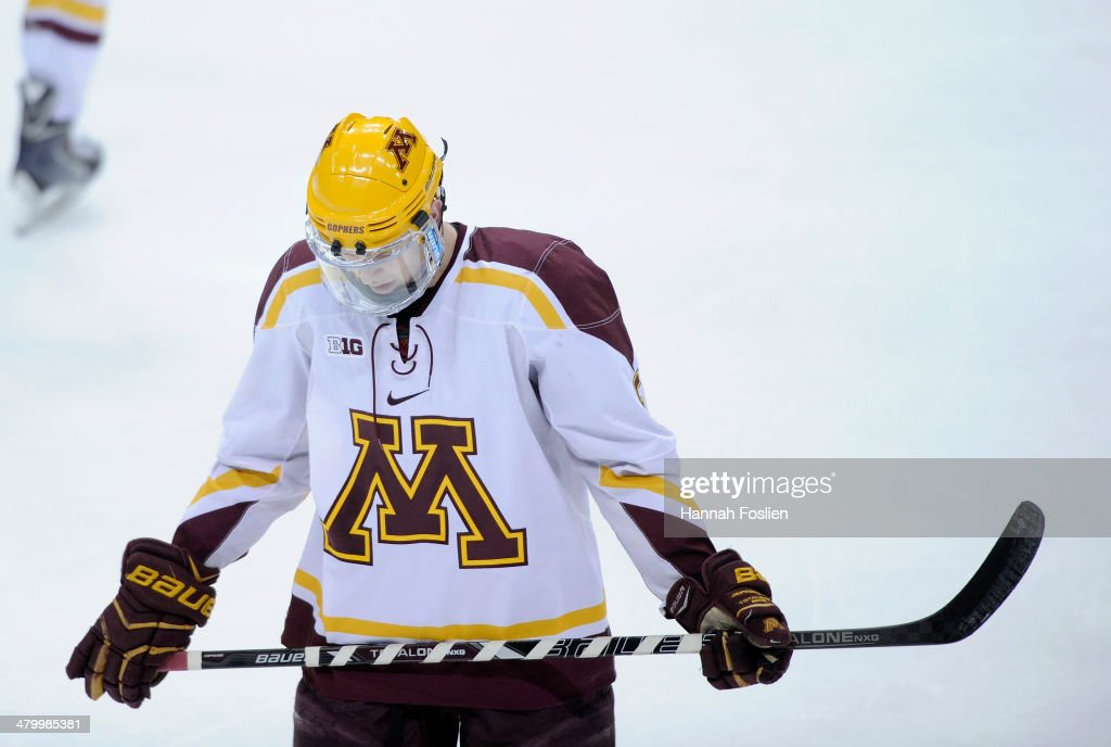 <a gi-track='captionPersonalityLinkClicked' href=/galleries/search?phrase=Mike+Reilly+-+Ice+Hockey+Player&family=editorial&specificpeople=12893936 ng-click='$event.stopPropagation()'>Mike Reilly</a> #5 of the Minnesota Golden Gophers reacts after Anthony Greco #14 of the Ohio State Buckeyes scored an empty net goal during the third period of the semifinal game of the Big Ten Men's Ice Hockey Championship on March 21, 2014 at Xcel Energy Center in St Paul, Minnesota. The Ohio State Buckeyes defeated the Minnesota Golden Gophers 3-1.