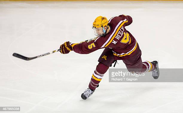 Mike Reilly of the Minnesota Golden Gophers takes a shot against the Minnesota Duluth Bulldogs during the NCAA Division I Men's Ice Hockey Northeast...