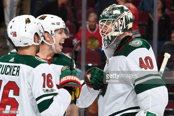 Mike Reilly of the Minnesota Wild celebrates with goalie Devan Dubnyk after the Wild defeated the Chicago Blackhawks 52 at the United Center on...
