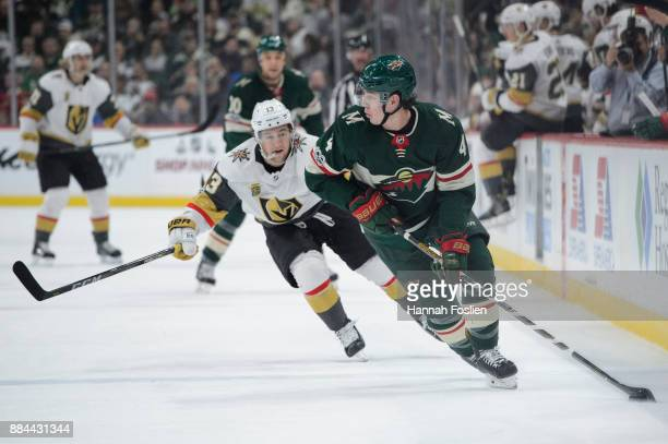 Mike Reilly of the Minnesota Wild controls the puck against Brendan Leipsic of the Vegas Golden Knights during the game on November 30 2017 at Xcel...