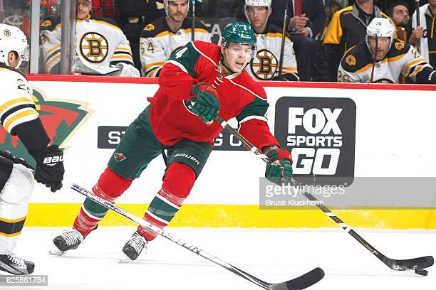 Mike Reilly of the Minnesota Wild passes the puck against the Boston Bruins during the game on November 17 2016 at the Xcel Energy Center in St Paul...