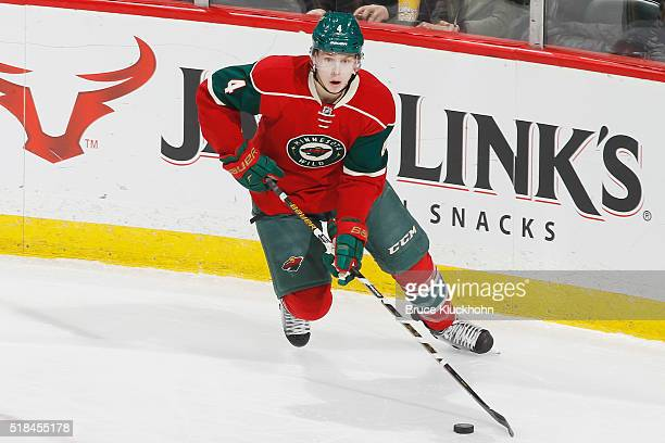 Mike Reilly of the Minnesota Wild skates with the puck against the Calgary Flames during the game on March 24 2016 at the Xcel Energy Center in St...