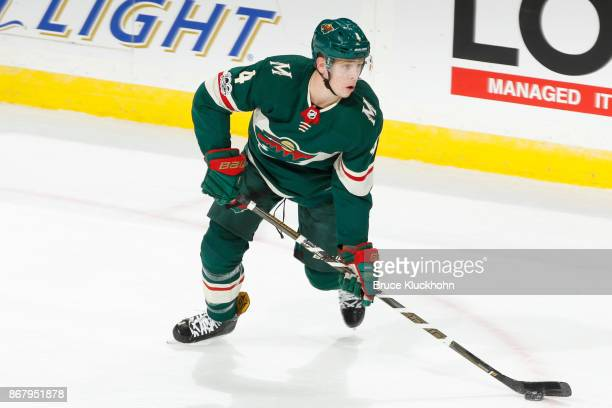 Mike Reilly of the Minnesota Wild skates with the puck against the New York Islanders during the game at the Xcel Energy Center on October 26 2017 in...