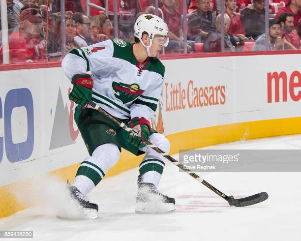 Mike Reilly of the Minnesota Wild stops behind the net with the puck against the Detroit Red Wings during the first ever NHL game at the new Little...
