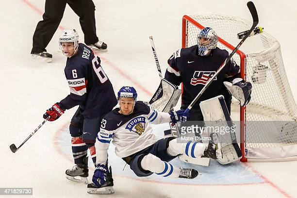 Mike Reilly of the United States and Ossi Louhivaara of Finland battle during the IIHF World Championship group B match between USA and Finland at...