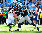 Mike Remmers of the Carolina Panthers blocks against Kroy Biermann of the Atlanta Falcons at Bank Of America Stadium on December 13 2015 in Charlotte...