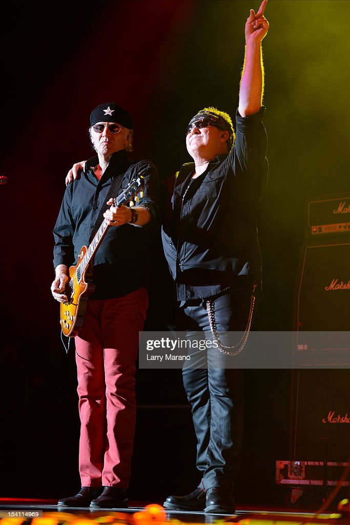 Mike Reno and Paul Dean of Loverboy perform at Cruzan Amphitheatre on October 13, 2012 in West Palm Beach, Florida.
