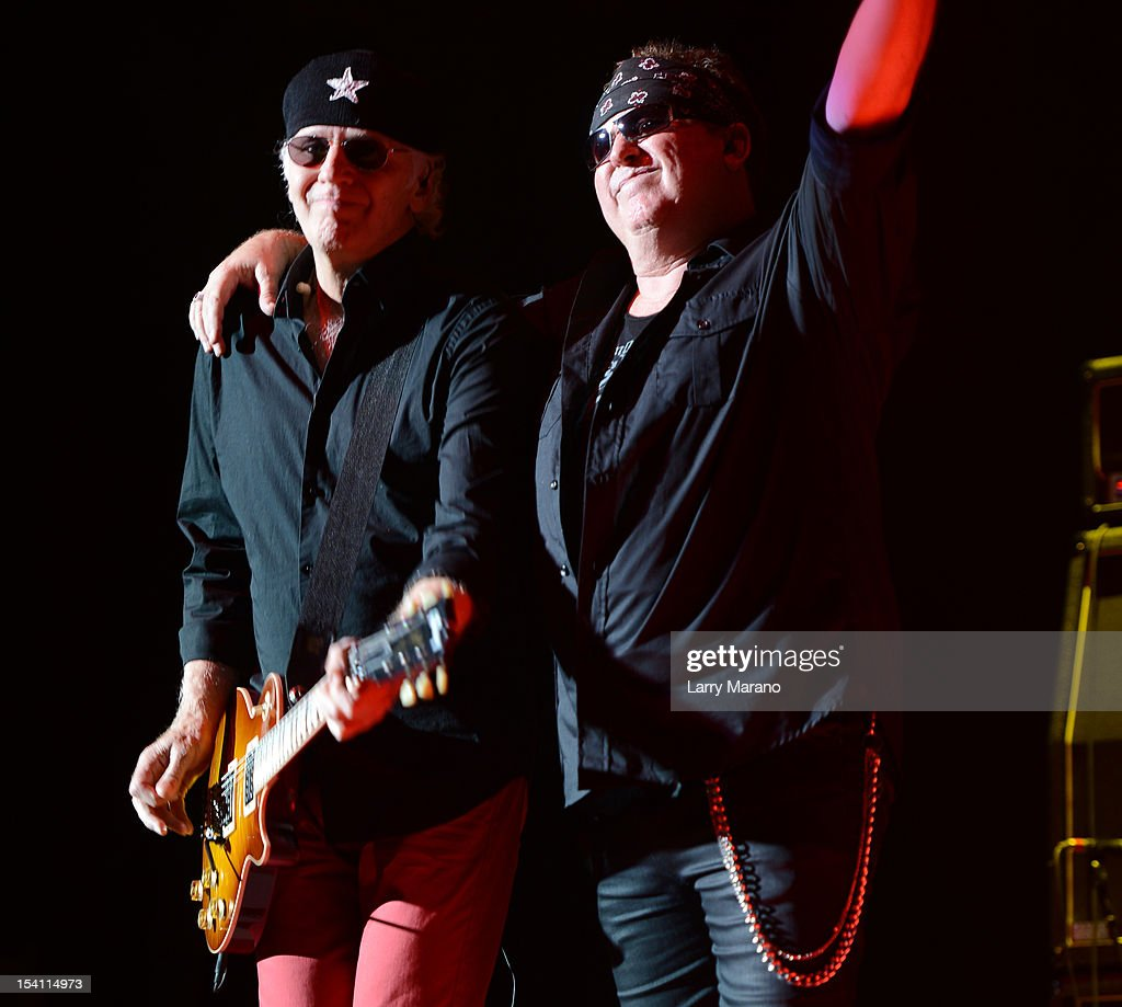 Mike Reno and Paul Dean of Loverboy perform at Cruzan Amphitheatre on October 13 2012 in West Palm Beach Florida