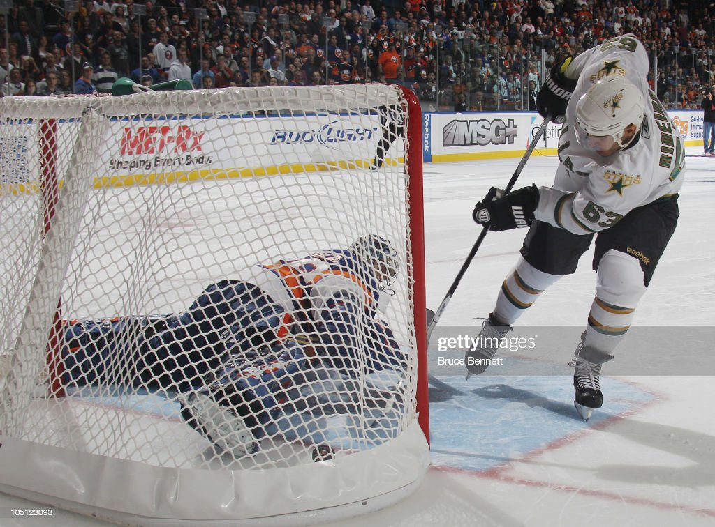 Mike Ribeiro of the Dallas Stars scores in the shootout to defeat the New York Islanders 54 at the Nassau Coliseum on October 9 2010 in Uniondale New...