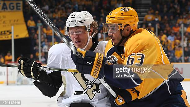 Mike Ribeiro of the Nashville Predators battles against Daniel Sprong of the Pittsburgh Penguins during an NHL game at Bridgestone Arena on October...