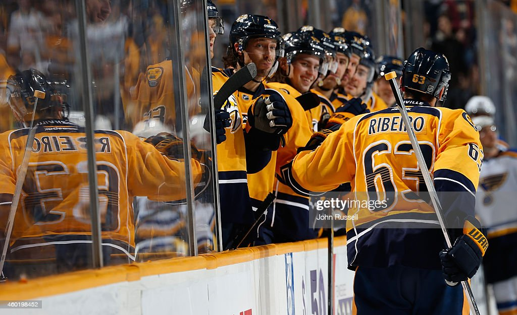 Mike Ribeiro of the Nashville Predators celebrates his goal along the bench against the St Louis Blues at Bridgestone Arena on December 4 2014 in...