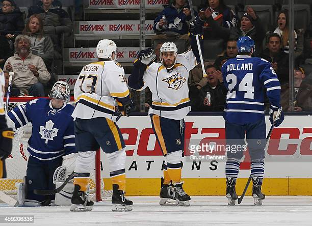 Mike Ribeiro of the Nashville Predators celebrates his goal at 53 seconds of the third period against James Reimer of the Toronto Maple Leafs and is...