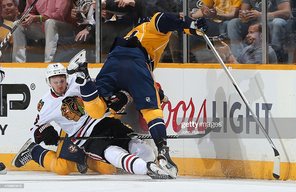 Mike Ribeiro #63 of the Nashville Predators checks Marcus Kruger #16 of the Chicago Blackhawks in Game Five of the Western Conference Quarterfinals during the 2015 NHL Stanley Cup Playoffs at Bridgestone Arena on April 23, 2015 in Nashville, Tennessee.