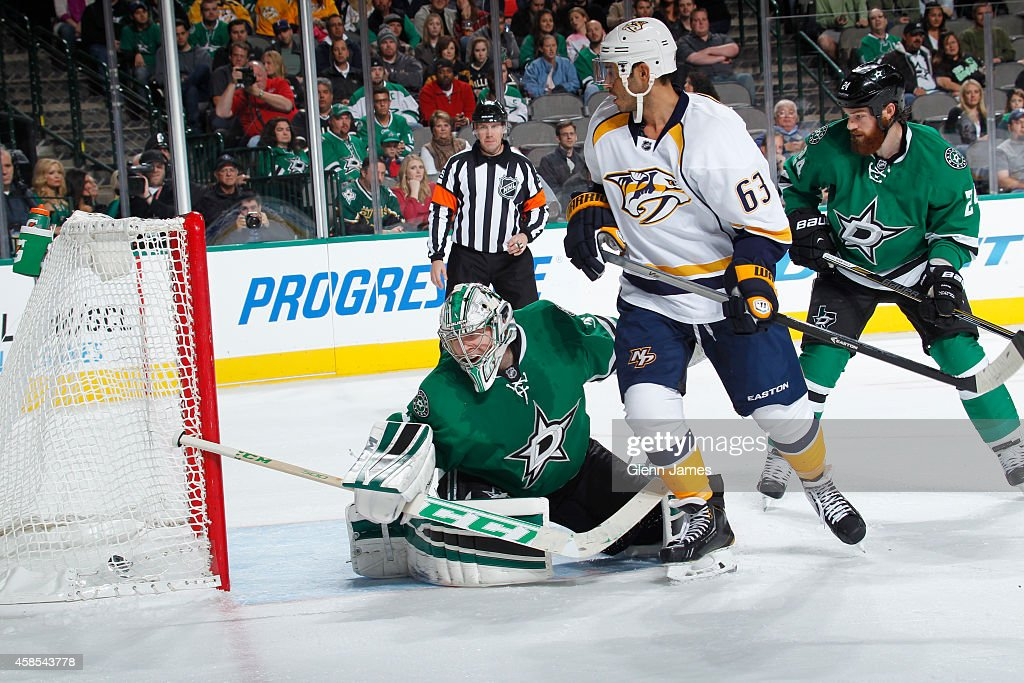Mike Ribeiro of the Nashville Predators gets a puck in past Kari Lehtonen of the Dallas Stars at the American Airlines Center on November 6 2014 in...