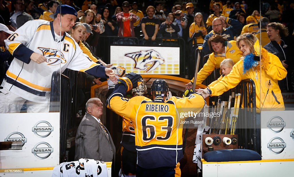 Mike Ribeiro of the Nashville Predators high fives fans after defeating the Arizona Coyotes in a shootout at Bridgestone Arena on October 21 2014 in...