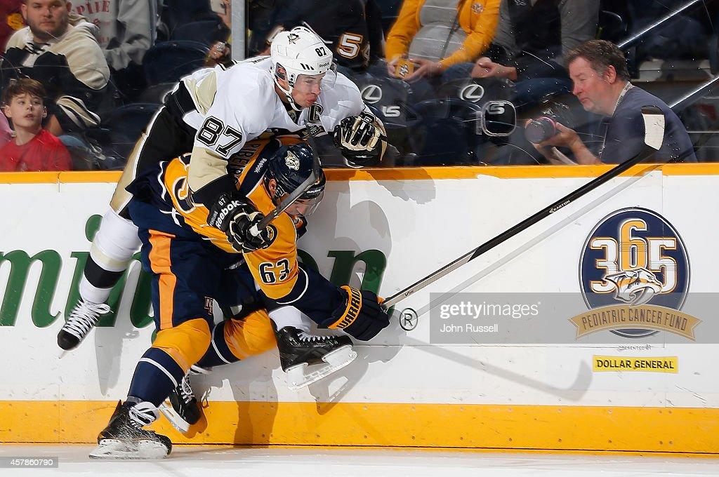 Mike Ribeiro of the Nashville Predators hip checks Sidney Crosby of the Pittsburgh Penguins at Bridgestone Arena on October 25 2014 in Nashville...