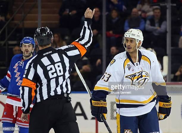 Mike Ribeiro of the Nashville Predators is ejected in the third period by referee Chris Lee during the game against the New York Rangers at Madison...