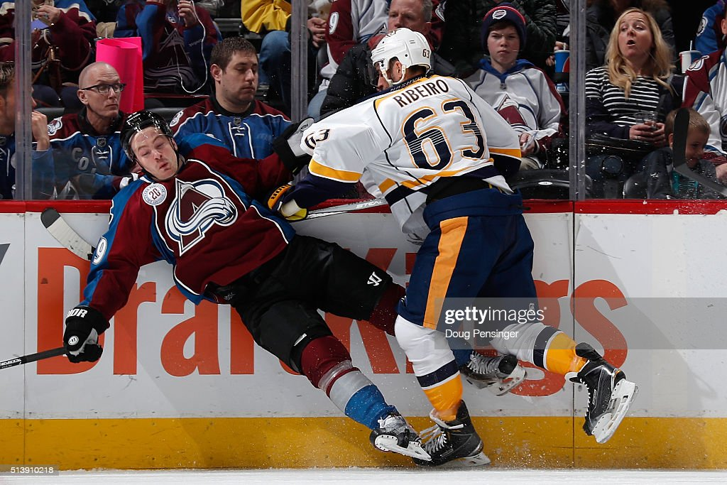 Mike Ribeiro of the Nashville Predators puts a hot on Mikkel Boedker of the Colorado Avalanche at Pepsi Center on March 5 2016 in Denver Colorado