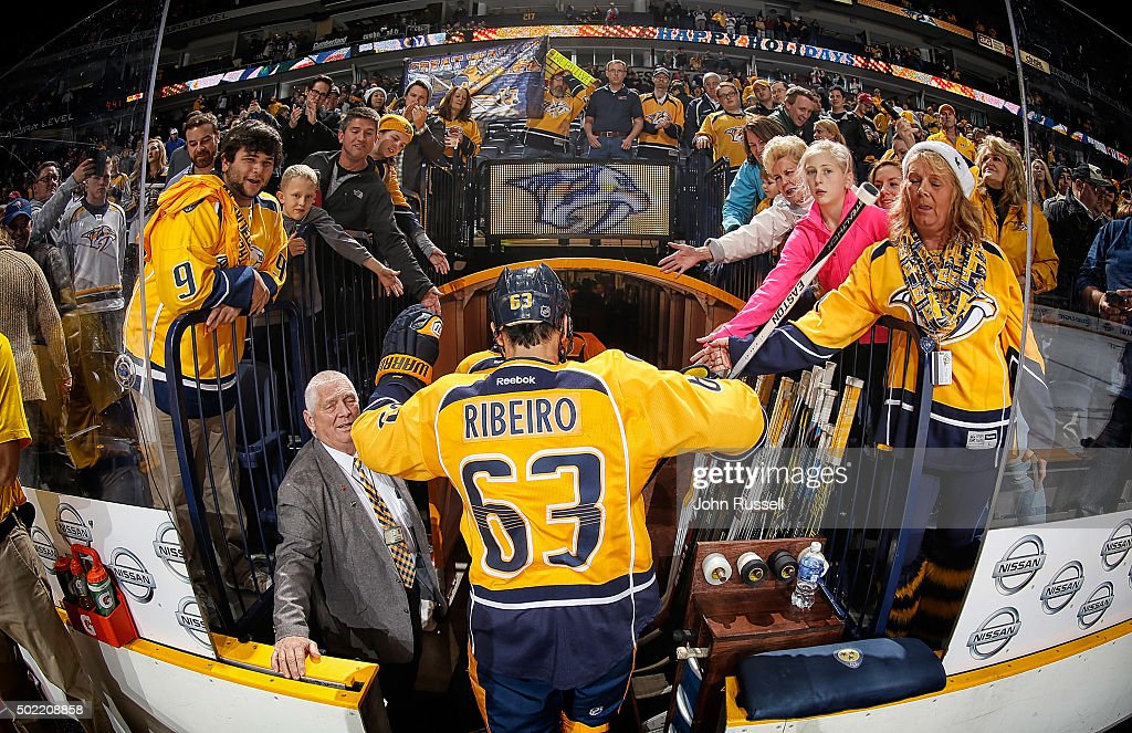 Mike Ribeiro of the Nashville Predators taps hands with fans after a 51 win against the Montreal Canadiens during an NHL game at Bridgestone Arena on...