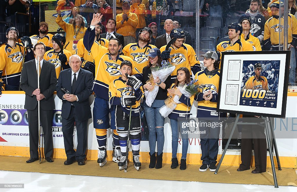 Mike Ribeiro of the Nashville Predators waves to fans as he is recognized for his 1000th NHL game with his family by his side prior to an NHL game...