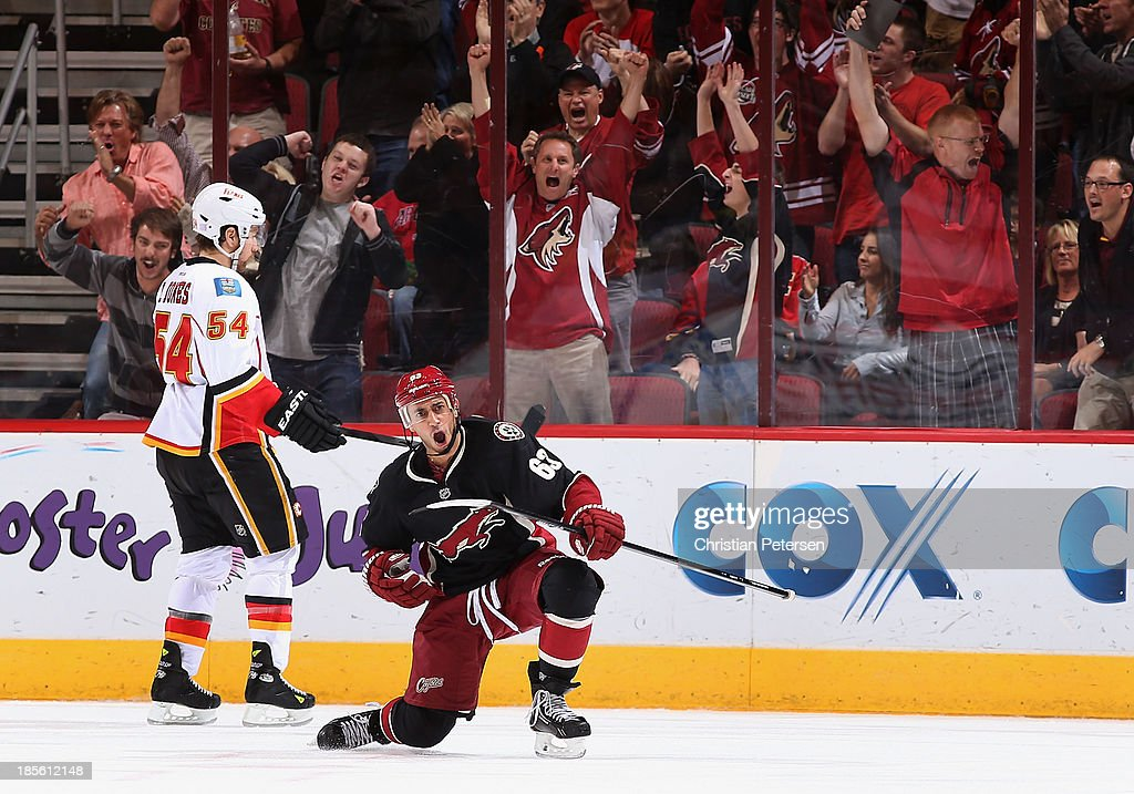 <a gi-track='captionPersonalityLinkClicked' href=/galleries/search?phrase=Mike+Ribeiro&family=editorial&specificpeople=203275 ng-click='$event.stopPropagation()'>Mike Ribeiro</a> #63 of the Phoenix Coyotes celebrates after scoring a third period goal against the Calgary Flames during the NHL game at Jobing.com Arena on October 22, 2013 in Glendale, Arizona. The Coyotes defeated the Flames 4-2.