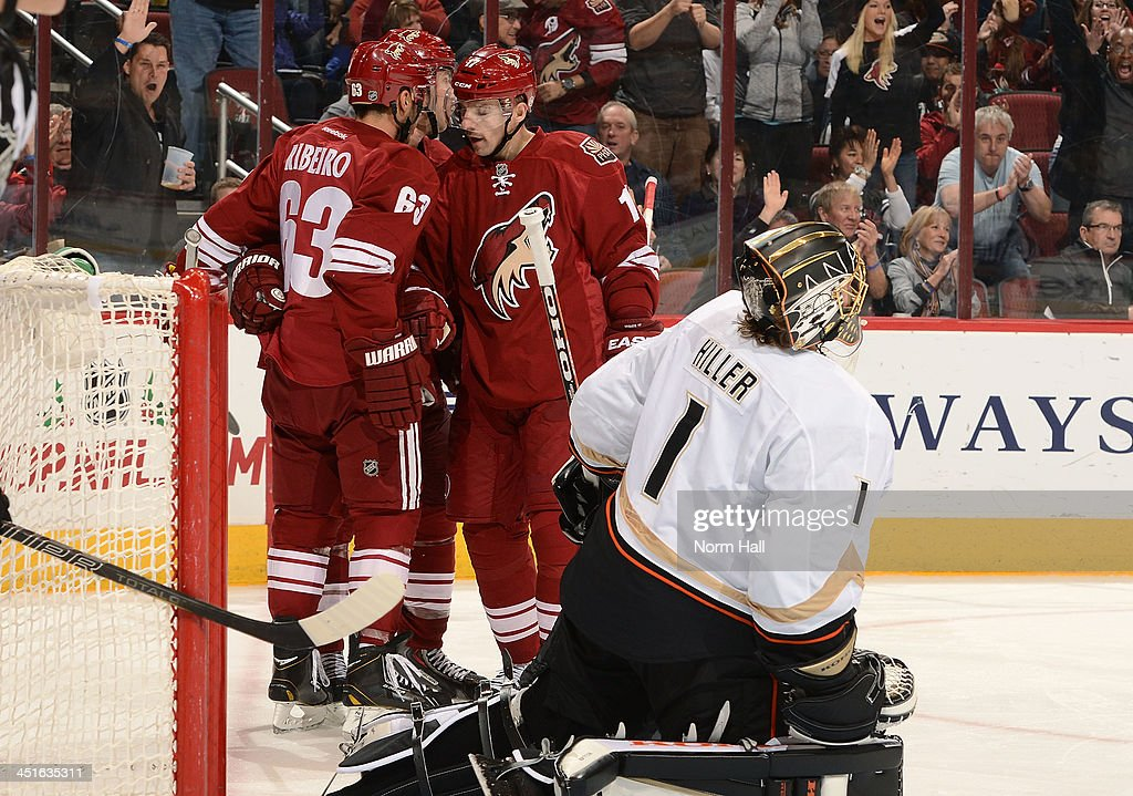 <a gi-track='captionPersonalityLinkClicked' href=/galleries/search?phrase=Mike+Ribeiro&family=editorial&specificpeople=203275 ng-click='$event.stopPropagation()'>Mike Ribeiro</a> #63 of the Phoenix Coyotes celebrates his goal with teammate <a gi-track='captionPersonalityLinkClicked' href=/galleries/search?phrase=Radim+Vrbata&family=editorial&specificpeople=204716 ng-click='$event.stopPropagation()'>Radim Vrbata</a> #17 as goaltender <a gi-track='captionPersonalityLinkClicked' href=/galleries/search?phrase=Jonas+Hiller&family=editorial&specificpeople=743364 ng-click='$event.stopPropagation()'>Jonas Hiller</a> #1 of the Anaheim Ducks reacts during the second period at Jobing.com Arena on November 23, 2013 in Glendale, Arizona.