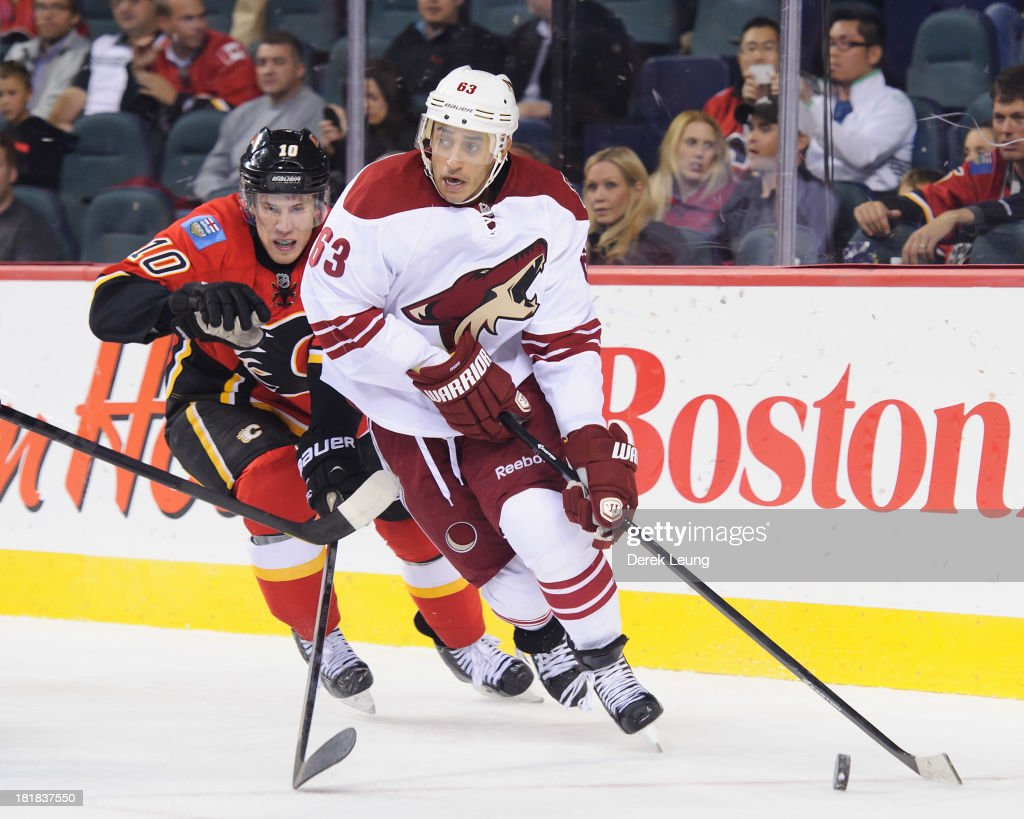 <a gi-track='captionPersonalityLinkClicked' href=/galleries/search?phrase=Mike+Ribeiro&family=editorial&specificpeople=203275 ng-click='$event.stopPropagation()'>Mike Ribeiro</a> #63 of the Phoenix Coyotes skates with the puck as Corban Knight #10 of the Calgary Flames chases him during a preseason NHL game at Scotiabank Saddledome on September 25, 2013 in Calgary, Alberta, Canada.