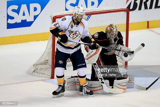 Mike Ribeiro of the the Nashville Predators tries to deflect a shot on goal while John Gibson of the the Anaheim Ducks stops it during the third...