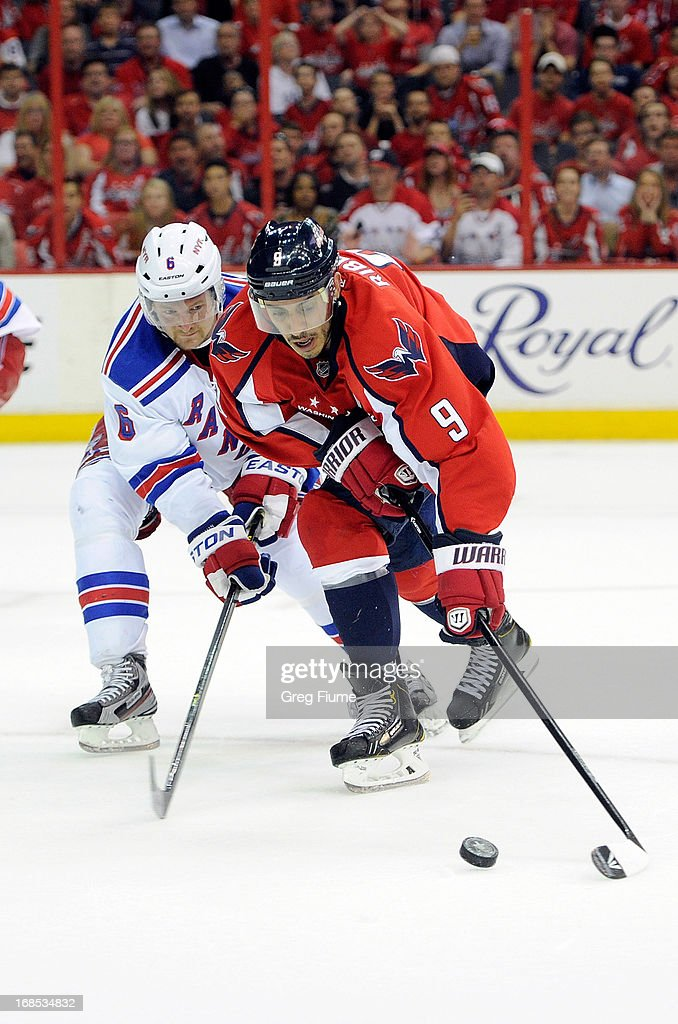 <a gi-track='captionPersonalityLinkClicked' href=/galleries/search?phrase=Mike+Ribeiro&family=editorial&specificpeople=203275 ng-click='$event.stopPropagation()'>Mike Ribeiro</a> #9 of the Washington Capitals battles for the puck in the third period against <a gi-track='captionPersonalityLinkClicked' href=/galleries/search?phrase=Anton+Stralman&family=editorial&specificpeople=2271901 ng-click='$event.stopPropagation()'>Anton Stralman</a> #6 of the New York Rangers in Game Five of the Eastern Conference Quarterfinals during the 2013 NHL Stanley Cup Playoffs at the Verizon Center on May 10, 2013 in Washington, DC.
