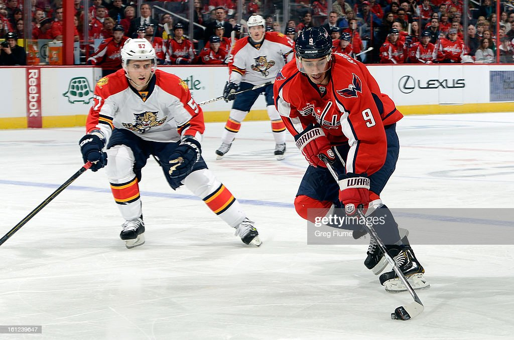 <a gi-track='captionPersonalityLinkClicked' href=/galleries/search?phrase=Mike+Ribeiro&family=editorial&specificpeople=203275 ng-click='$event.stopPropagation()'>Mike Ribeiro</a> #9 of the Washington Capitals brings the puck down the ice against <a gi-track='captionPersonalityLinkClicked' href=/galleries/search?phrase=Marcel+Goc&family=editorial&specificpeople=541626 ng-click='$event.stopPropagation()'>Marcel Goc</a> #57 of the Florida Panthers at the Verizon Center on February 9, 2013 in Washington, DC.